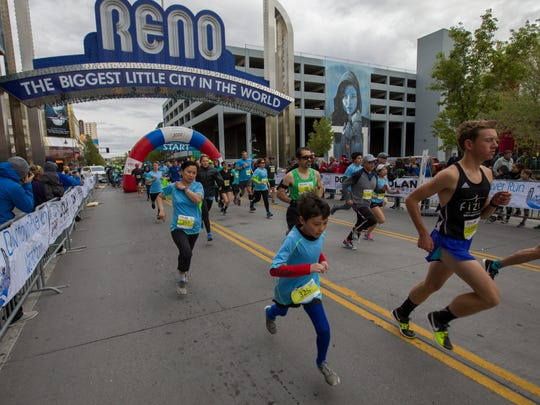 Runners start the half-marathon portion of the Downtown