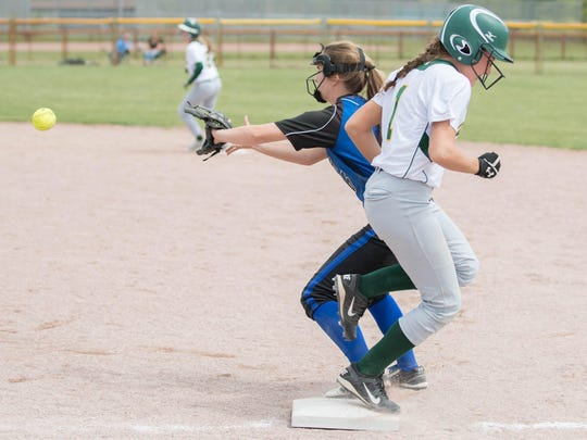 Pennfield's Kaitlyn Baird makes to first against Harper Creek during All-City Softball finals.