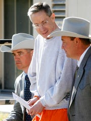 Texas Ranger Nick Hanna, left, escorts Warren Jeffs, center, with the help of a fellow Ranger from the Tom Green County Courthouse Wednesday afternoon following his arraignment after being extradited from Utah.