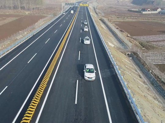 Autonomous driving cars being tested out on a section of Binlai Highway in Shandong province.