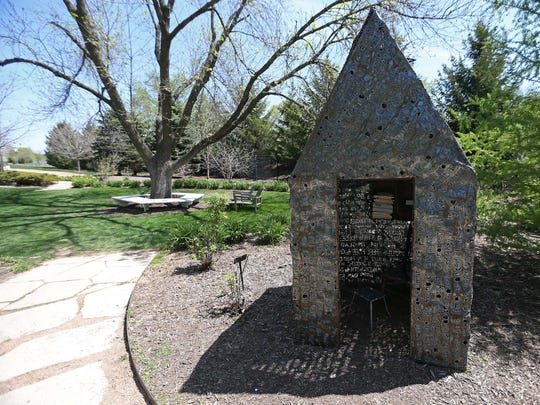 The Text Hut tree house by Skip Willits at Reiman Gardens in Ames on Tuesday, May 5, 2015. Inside the house is a small free library and journal where visitors can leave their thoughts.