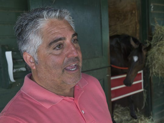 Trainer Greg Sacco of Ocean Township inside his barn at Monmouth Park.