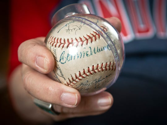 In this Oct. 21, 2016 photo, retired Rev. Allen Broyles, 82, of Rio Rancho, N.M. who was a batboy the last time the Cleveland Indians won the World Series in 1948, holds one of his prize baseballs, one signed by Connie Mack at his home.
