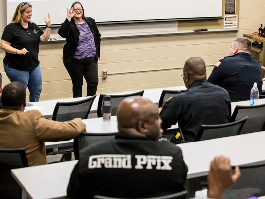 February 17, 2017 - Summer Chappell (left), director of community services at Deaf Connect of the Mid-South Inc., signs alongside her mother, Sheila Chappell, an American Sign Language instructor, during a class for Crisis Intervention Team officers at the Memphis Police Department Training Academy. Summer Chappell is teaching officers over the course of 10 weeks to help with their interactions within the deaf community in Memphis.