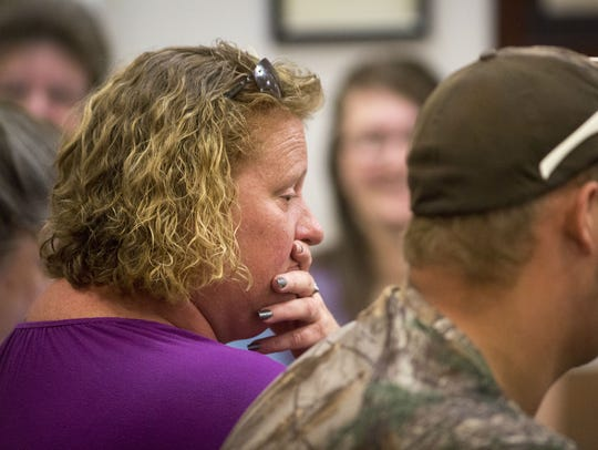 April Manley, James Manley's wife, sits in court Wednesday