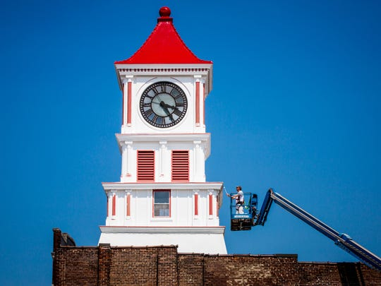 A man paints the iconic clock tower in Hopkinsville,