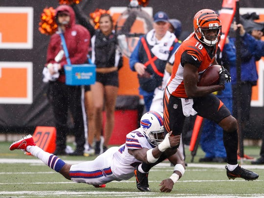 Cincinnati Bengals wide receiver A.J. Green (18) is tackled by Buffalo Bills defensive back Shareece Wright in the first half of an NFL football game, Sunday, Oct. 8, 2017, in Cincinnati.