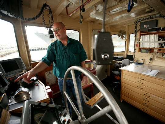Tugboat Captain Matthew Probst gives a tour of the Canonchet's bridge at Naval Base Kitsap Bremerton.