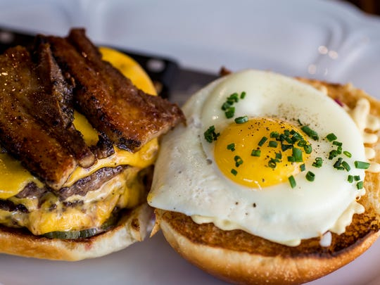 Sacred Beast's double burger with egg and pork belly.