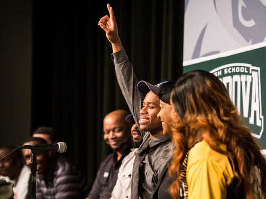 April 13, 2018 - Cordova point guard Tyler Harris, center, celebrates after announcing that he was signing a national letter of intent with the Tigers.