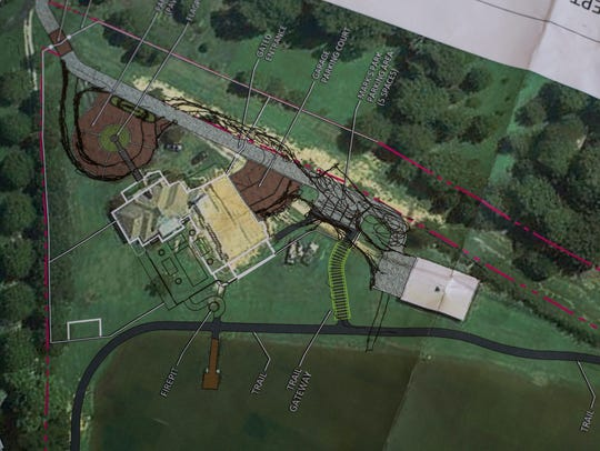 """April 19, 2018 - Parts of the plan for Mark's Park are seen on the dining room table of Joe and Gayle Ennis. Joe and Gayle Ennis bought their property on Springmont Trail in Collierville more than a decade ago and now it is where Joe will realize his dream of building Mark's Park, a special """"humorous"""" nature park built exclusively for children and adults with autism."""
