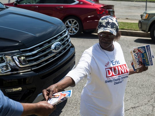 May 01, 2018 - Faye Donaldson hands out campaign materials for Janis Fullilove and Eric Dunn while campaigning outside of Springdale Baptist Church on Election Day on Tuesday.