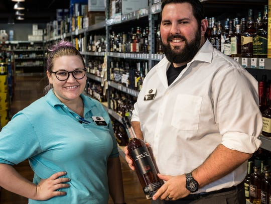 Assistant manager Angie Adams and general manager Ryan Gill show off a bottle of the first edition of Doc's Wine, Spirits & More's Doc.52. The brand will release its seventh edition on Friday.