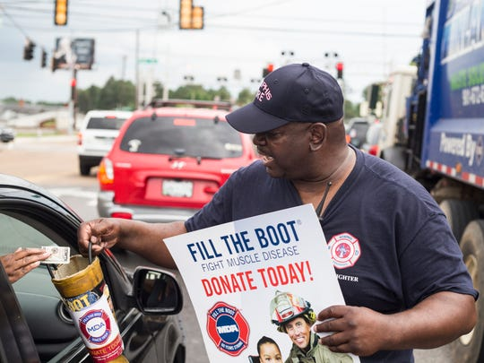 May 25, 2018 - Tavio Taylor, a private at Memphis Fire Station #21, collects donations for the Muscular Dystrophy Association along South Mendenhall Road.