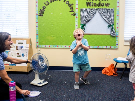 July 12, 2018 - Daniel Bell, 2, center, reacts after catching a bubble during time in Sue Montgomery's classroom at the Memphis Oral School for the Deaf in Germantown. Memphis Oral School for the Deaf has new leadership in Executive Director Lauren Hays and Principal Shannon Hall.