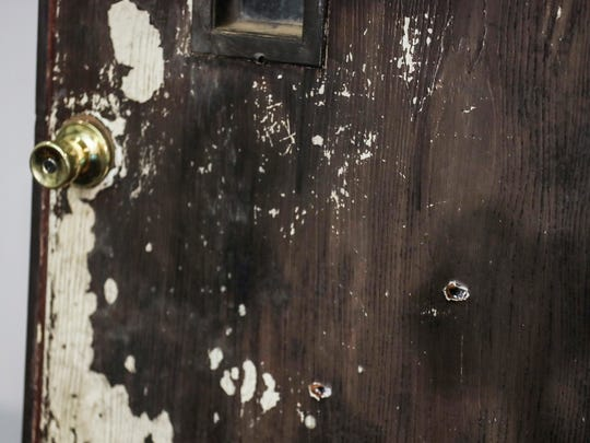 The door of Ismael Lopez's home, with bullet holes in it, is seen while Murray Wells, the lawyer for the family of Ismael Lopez, not pictured, spoke during a press conference about the grand jury's decision to decline to indict the officer who shot Lopez on July 26, 2018.