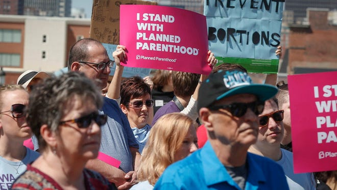 Supporters of Planned Parenthood gathered for a rally on Friday, May 4, 2018, at the Iowa Capitol grounds in Des Moines. The rally called for Gov. Kim Reynolds to veto SF 359, the six-week abortion ban.