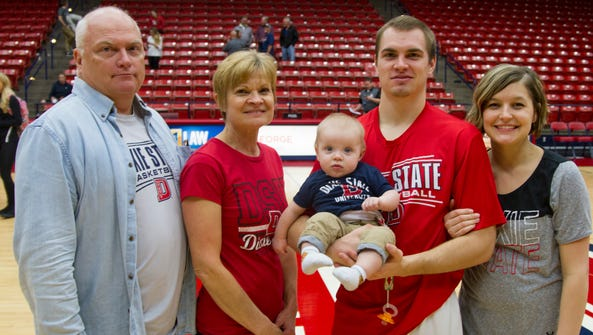 Dixie State guard Mason Sawyer with his wife, son and