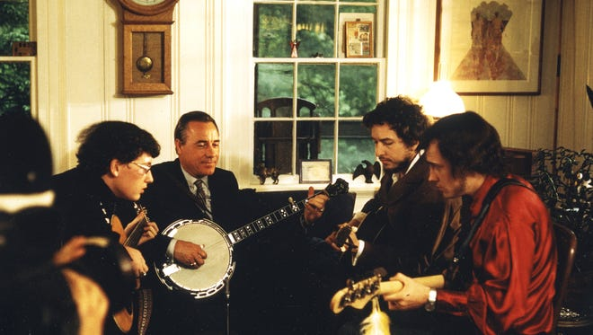 Bob Dylan, second from right, plays with Earl Scruggs, second from left and two of Scruggs sons. From the Country Music Hall of Fame and Museum exhibit Dylan, Cash, and the Nashville Cats: A New Music City.
