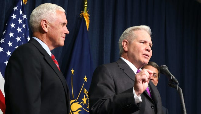 Indiana Gov. Mike Pence (left) appointed Democrat Jim Schellinger president of the Indiana Economic Development Corp. in July 2015.