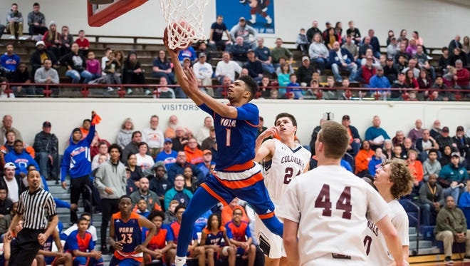 York High's Kyree Generett scores on a layup during play against New Oxford in the first round of the PIAA District III Class 5A Championships Feb. 19, 2018. York High won 57-53 and will play Greencastle-Antrim in the quarterfinals on Thursday.