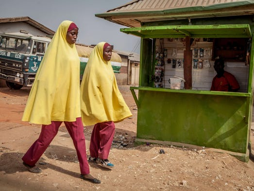 Nigerian students dressed in conservative muslim attire