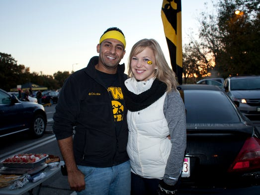 Anil Alimohd and Laura Swenson tailgate before the