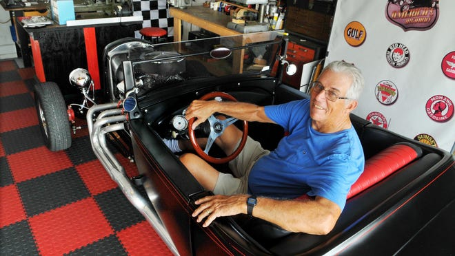1. Bill Oakley of Rockledge shows off his cool garage, complete with custom flooring and high-end power tools, mostly used for making one-off parts for his 1929 Ford Roadster that he has been working on for four years.