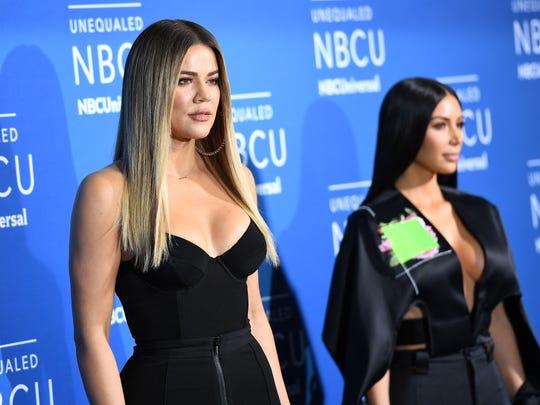 Khloe Kardashian, left,  and Kim Kardashian West attend the NBCUniversal Upfront, Monday.