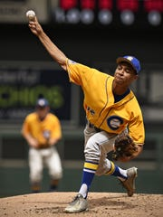 Cathedral pitcher Brindley Theisen throws to a Minnehaha
