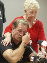 12/11/2008--Photo by Craig Bailey/Florida Today--William Dillon wipes his eyes as he speaks during a press conference Thursday in Viera. Comforting him is his mother Amy.