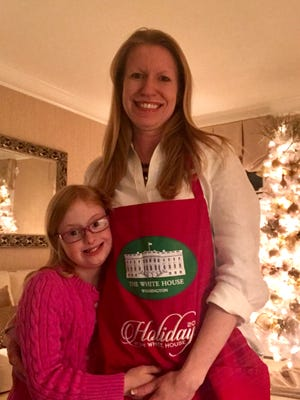 Moorestown's Dria Law is shown at her home with daughter Julianna. Law went to Washington, D.C. last month to help decorate the White House for the holidays. She has a gift for holiday decorating.