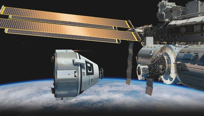 An image released by NASA on December 1, 2014 shows an artist's impression of a Crew Space Transportation (CST)-100 spacecraft approaching the International Space Station. NASA announced it has approved Boeing's first milestone toward launching crews to the space station from the U.S. under a Commercial Crew program contract.