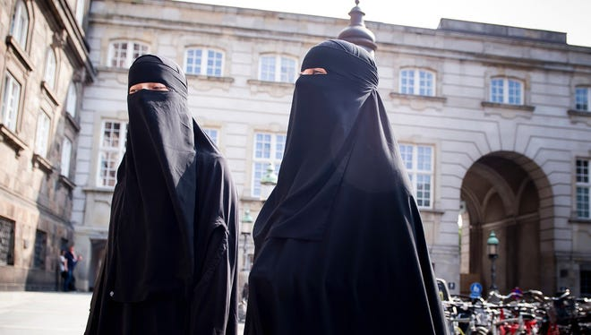 File picture - Women in niqabs walk, in front of the Danish Parliament at Christiansborg Castle, in Copenhagen, Denmark, Thursday May 31. 2018