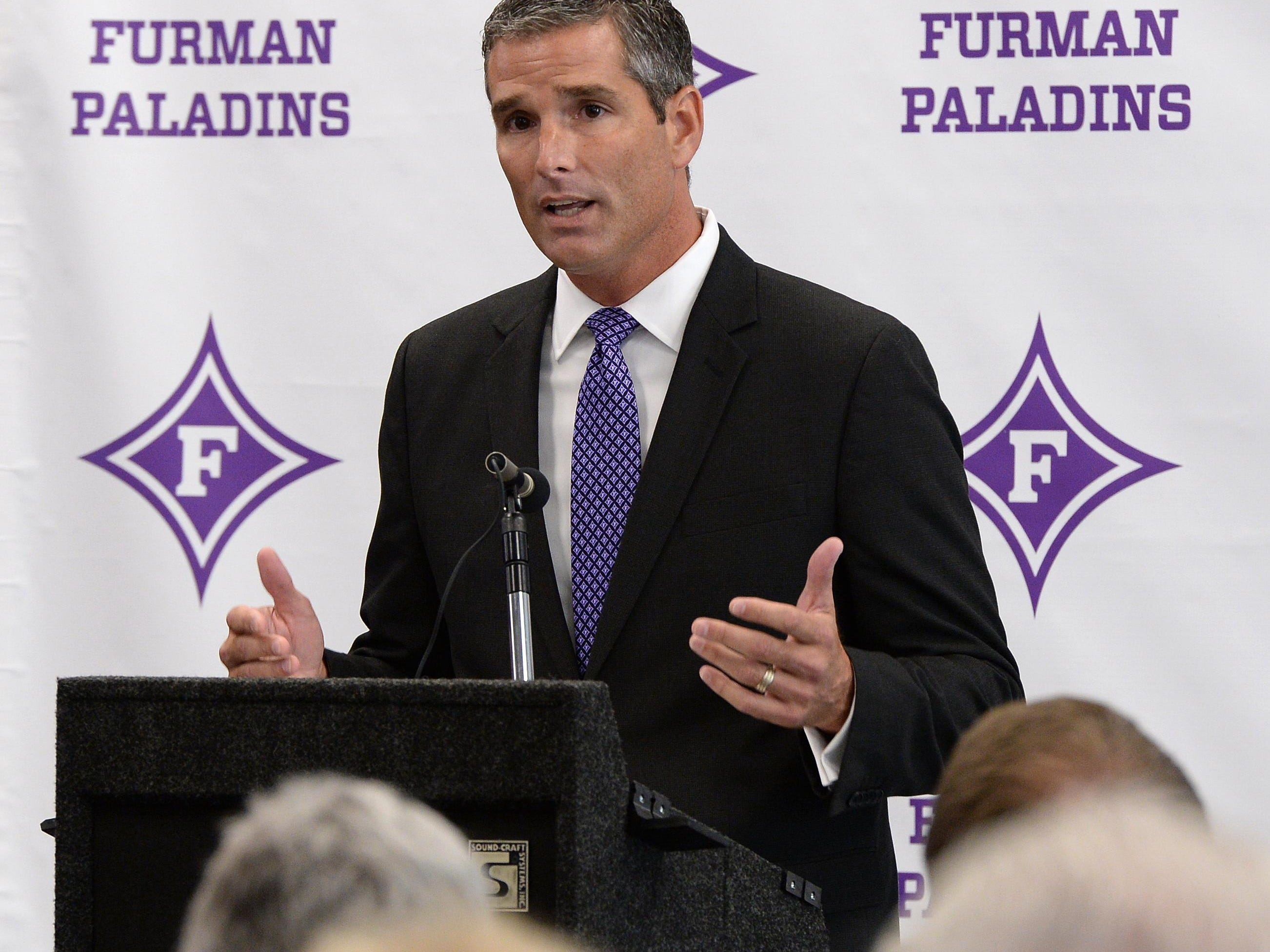 New Furman athletic director Mike Buddie is introduced during a press conference Wednesday, July 29, 2015 at Furman