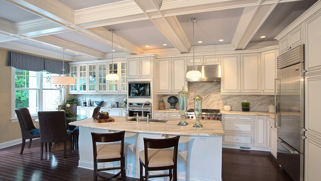 This center-island kitchen with granite counters and backsplashes can be yours at Legacy of Mountain Lakes.