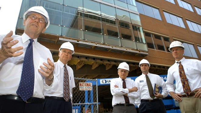 From left, Republican nominee for governor Mike Fisher, Vice President Commissioner James Donahue, Louis J. Appell Jr., chairman, Susquehanna Pfaltzgraff Co., President Commissioner Chris Reilly, and Joe Wagman, president of Wagman Construction, stand outside the Susquehanna Commerce Center in this 2002 photo.