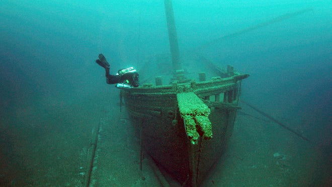 A diver inspects the Walter B. Allen, a schooner that sank in 1880 while en route to Manitowoc.