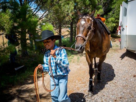 Marcus Lujan,10, leads quarterhorse Coco at the Rockin'