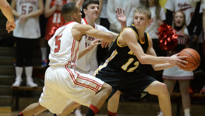 FILE -- Mt. Vernon's Michael Ertel is pressured by Richmond's Isaiah Rader, left, and Tommy Luce.
