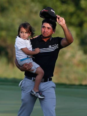 Jason Day, holding his son Dash, acknowledges the cheers after winning the PGA Championship on Sunday at Whistling Straits.