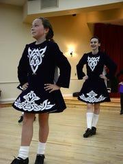 Tir Na Nog Irish Step Dancers entertain in the parish hall at St. John the Evangelist Catholic Church.