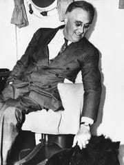 Shown in an undated photo of United States President Franklin D. Roosevelt with his pet dog. (AP)