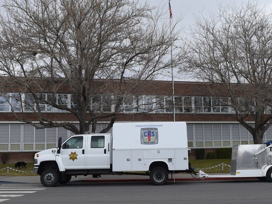 The bomb squad truck is parked outside Sparks High School, where an explosion threat was called on Monday.