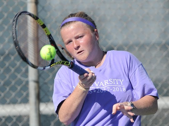 Wylie's Elle Schroeder returns a shot in her girls doubles match against a Cooper team. Schroeder and Andrea McMillan beat Cooper's Josephine Bandora and Liana Burris 6-1, 6-0 at the Cougar Classic on Friday, March 2, 2018 at Rose Park Tennis Center.