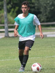 Arlington High School's Anthony Germano looks to pass the ball during preseason soccer tryouts held at Stringham Park in LaGrangeville on Tuesday.