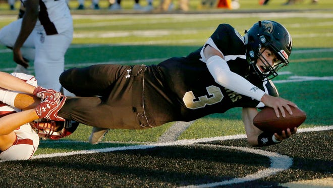 Corning's Cian Collin lands in the end zone during the first quarter of Friday night's home football game against Johnson City.