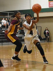 Holy Savior Menard point guard Kennedy Perry (4) looks