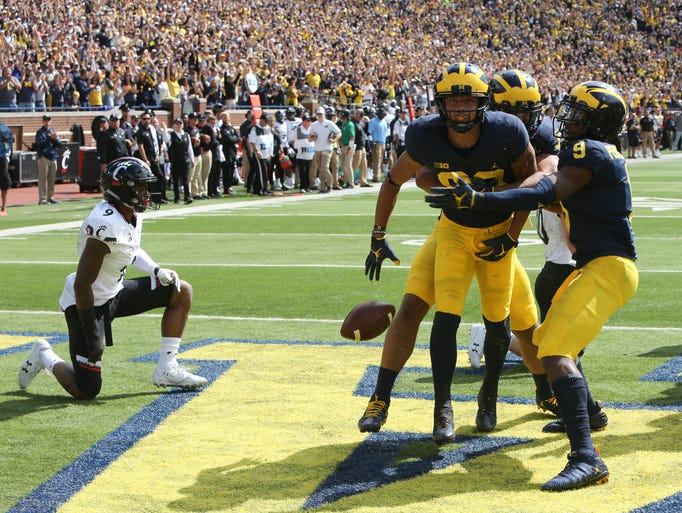 Michigan's Grant Perry celebrates his 33-yard touchdown