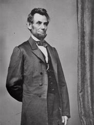 President Abraham Lincoln mourns the loss of his young